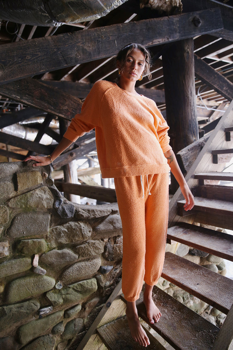 Model wearing the lady & the sailor Vintage Sweatpant in Tangerine Boucle.