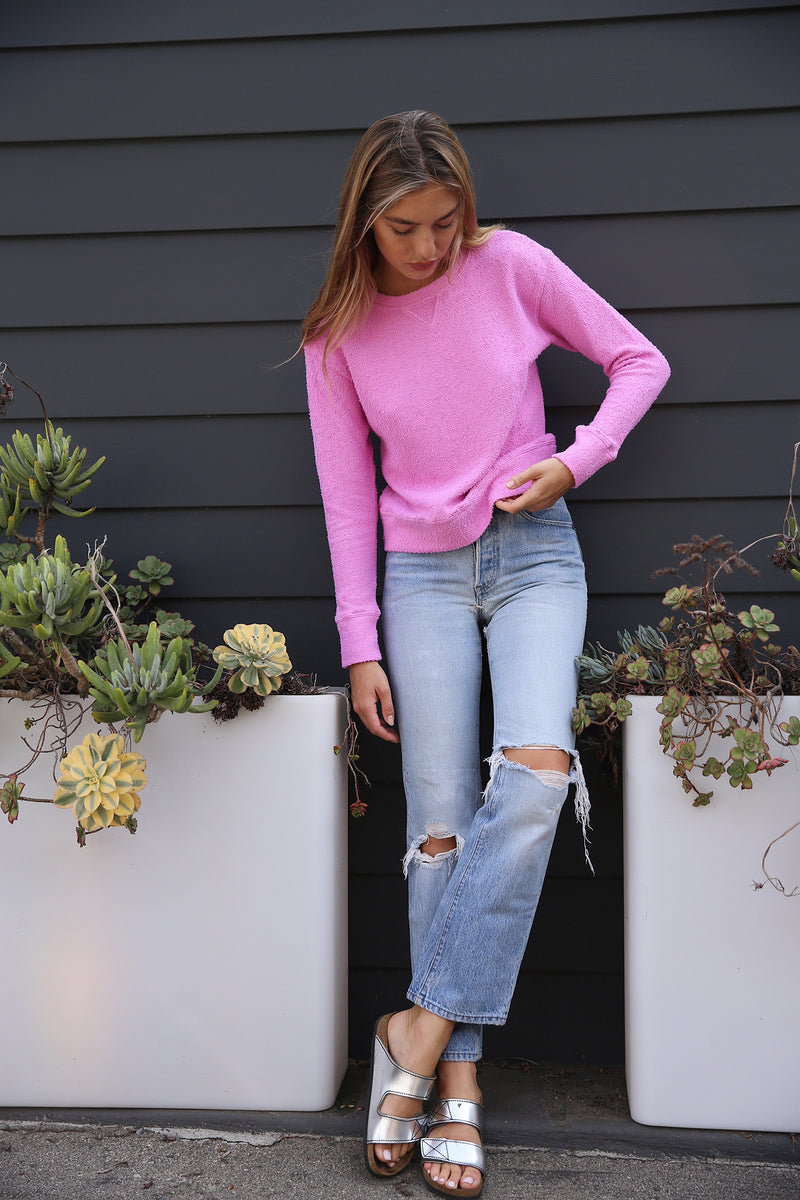 Model wearing the lady & the sailor Varsity Crewneck in Bubblegum Boucle.
