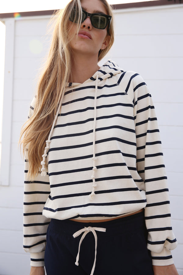 Model wearing the lady & the sailor Tomboy Hoodie in Nautical Stripe.