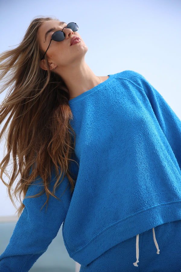 Model wearing the lady & the sailor Brentwood Sweatshirt in Surf Boucle.