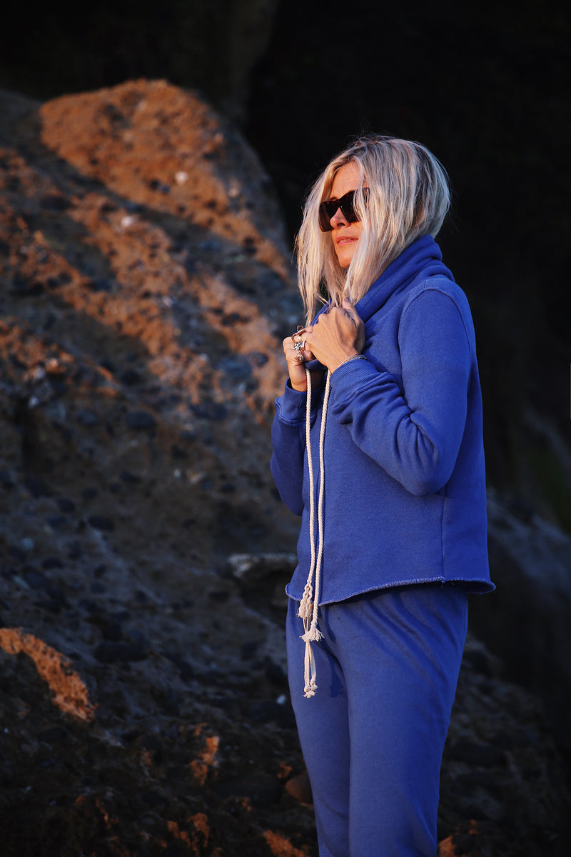 Model wearing the lady & the sailor Raw Bottom Hoodie Laguna Blue Fleece.