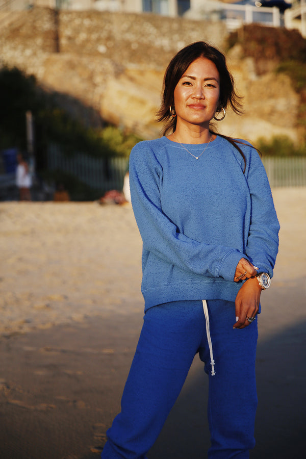 Model wearing the lady & the sailor Brentwood Sweatshirt in Laguna Blue Boucle.