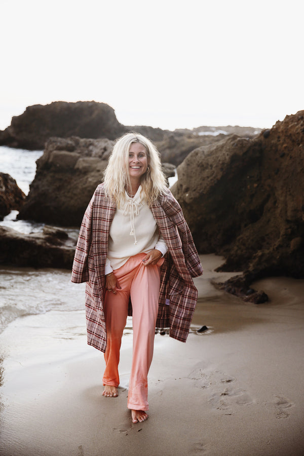 Model wearing the lady & the sailor Heather Pant in Sunset Pink Organic Cotton.