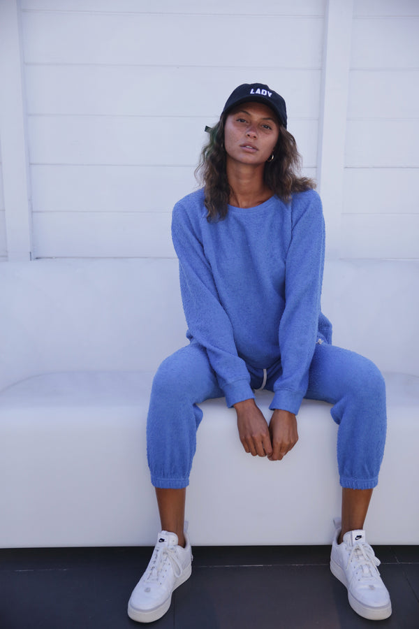 Model wearing the lady & the sailor Brentwood Sweatshirt in Bahama Blue Boucle.