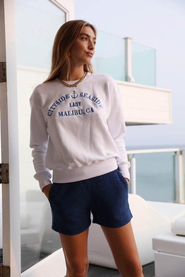 Model wearing the lady & the sailor Weekend Shorts in Royal Boucle.