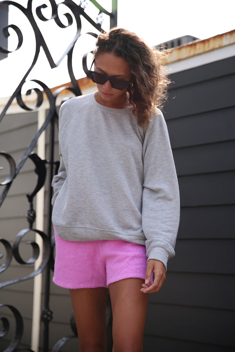 Model wearing the lady & the sailor Brentwood Sweatshirt in Heather Grey Terry.