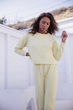 Model wearing the lady & the sailor Vintage Sweatshirt in Citrus Yellow Boucle.