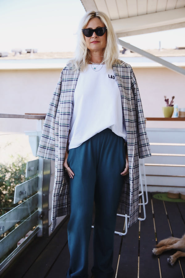 Model wearing the lady & the sailor Midi Blazer in Ivory Plaid.