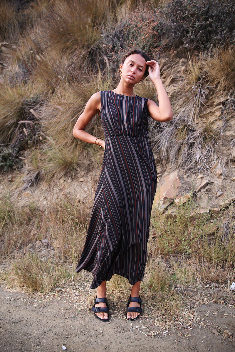 Model wearing the lady & the sailor Margaux Dress in black stripe.