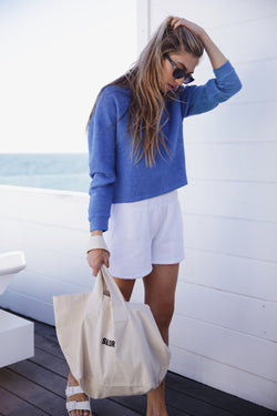Model wearing the lady & the sailor Vintage Sweatshirt in Bahama Blue Boucle.