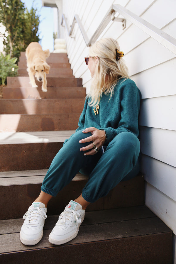Model wearing the lady & the sailor Vintage Sweatpant in Emerald Bay Green Organic Cotton.