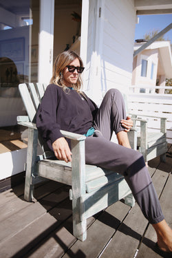 Model wearing the lady & the sailor Vintage Sweastpant in Slate Organic Cotton.
