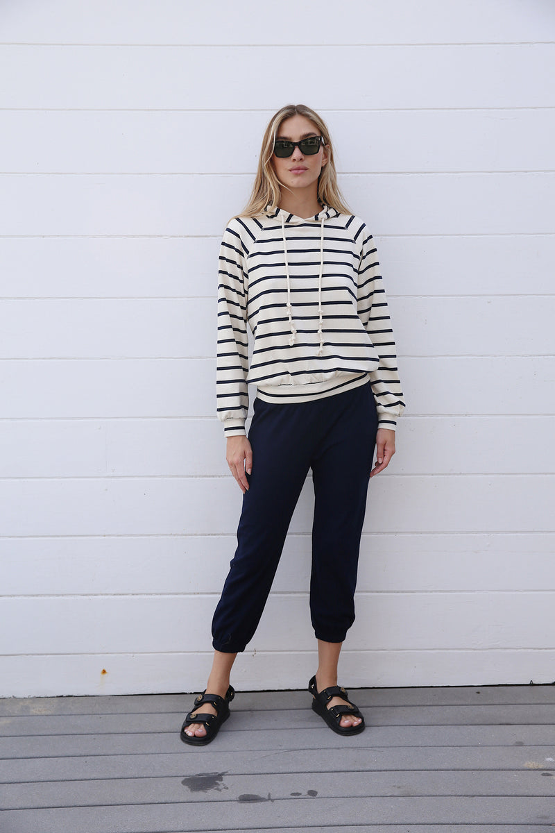 Model wearing the lady & the sailor Vintage Sweatpants in Navy Mineral Terry.