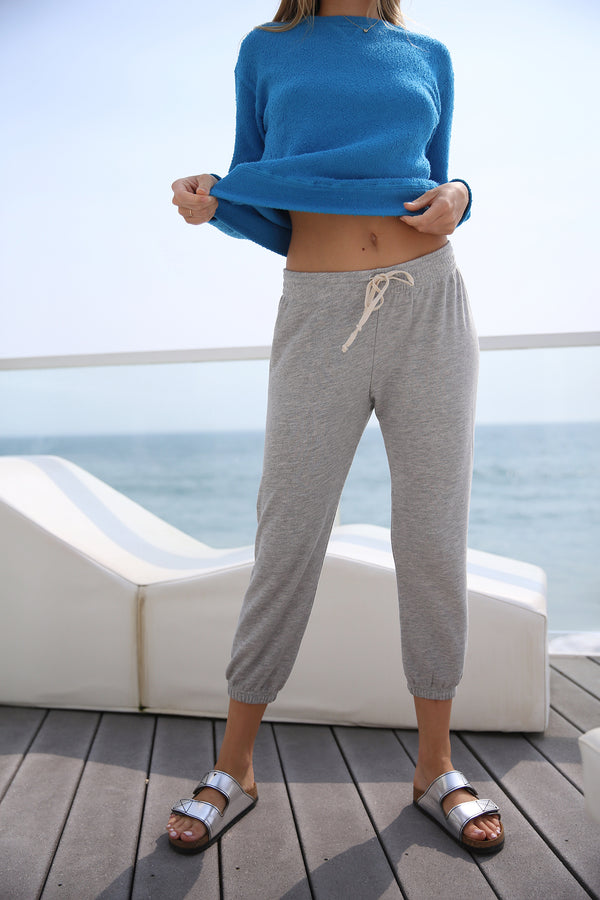 Model wearing the lady & the sailor Vintage Sweatpant in Heather Grey Terry.