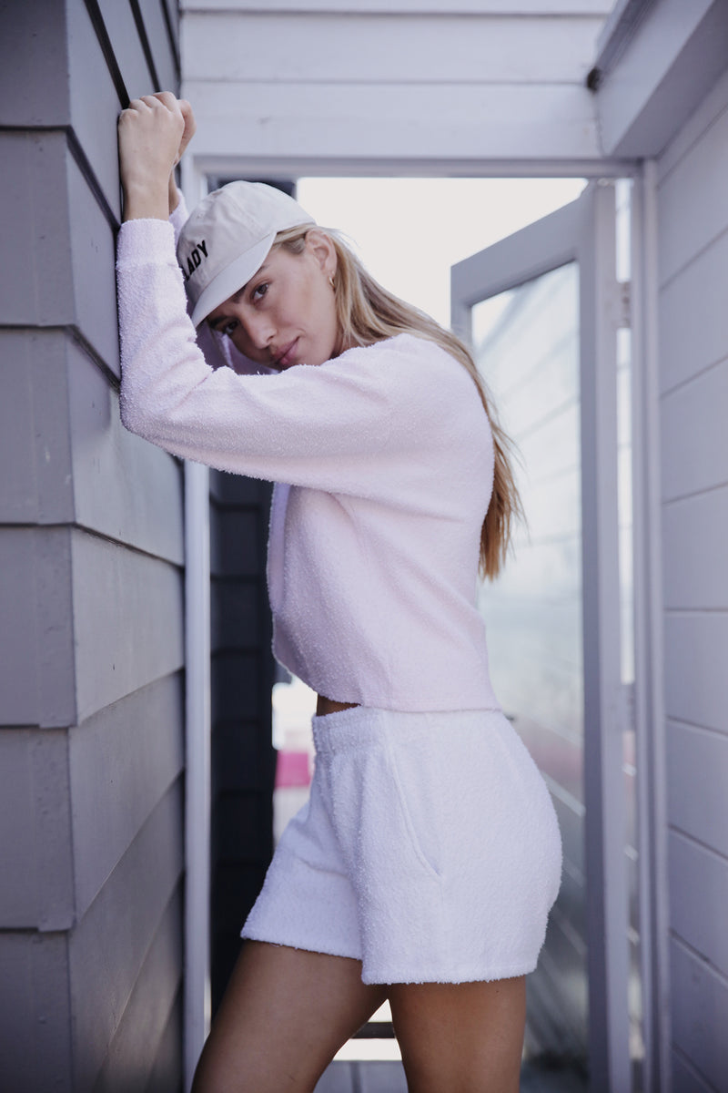 Model wearing the lady & the sailor Vintage Sweatshirt in Baby Pink Boucle.