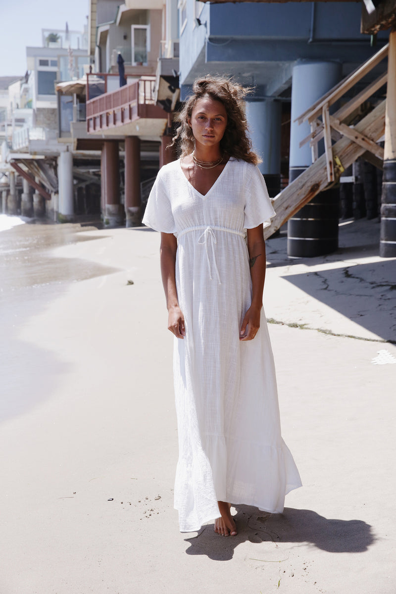 Model wearing the lady & the sailor Louie Dress in White Gauze.