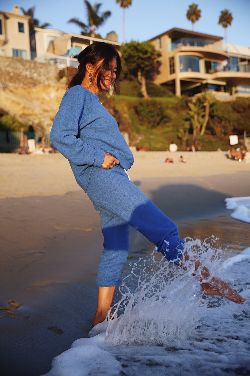 Model wearing the lady & the sailor Vintage Sweatpant in Laguna Blue Boucle.