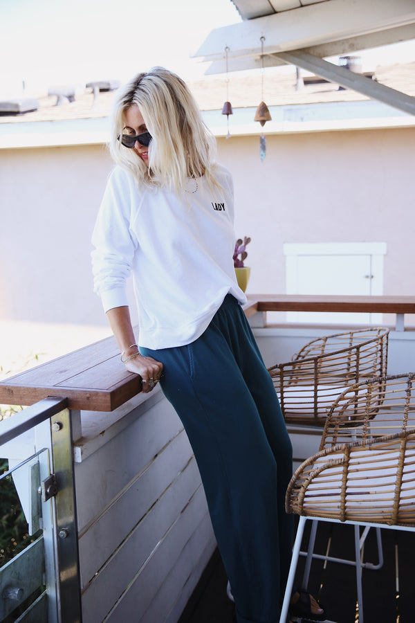 Model wearing the lady & the sailor the Heather Pant in Emerald Bay Green Organic Cotton.