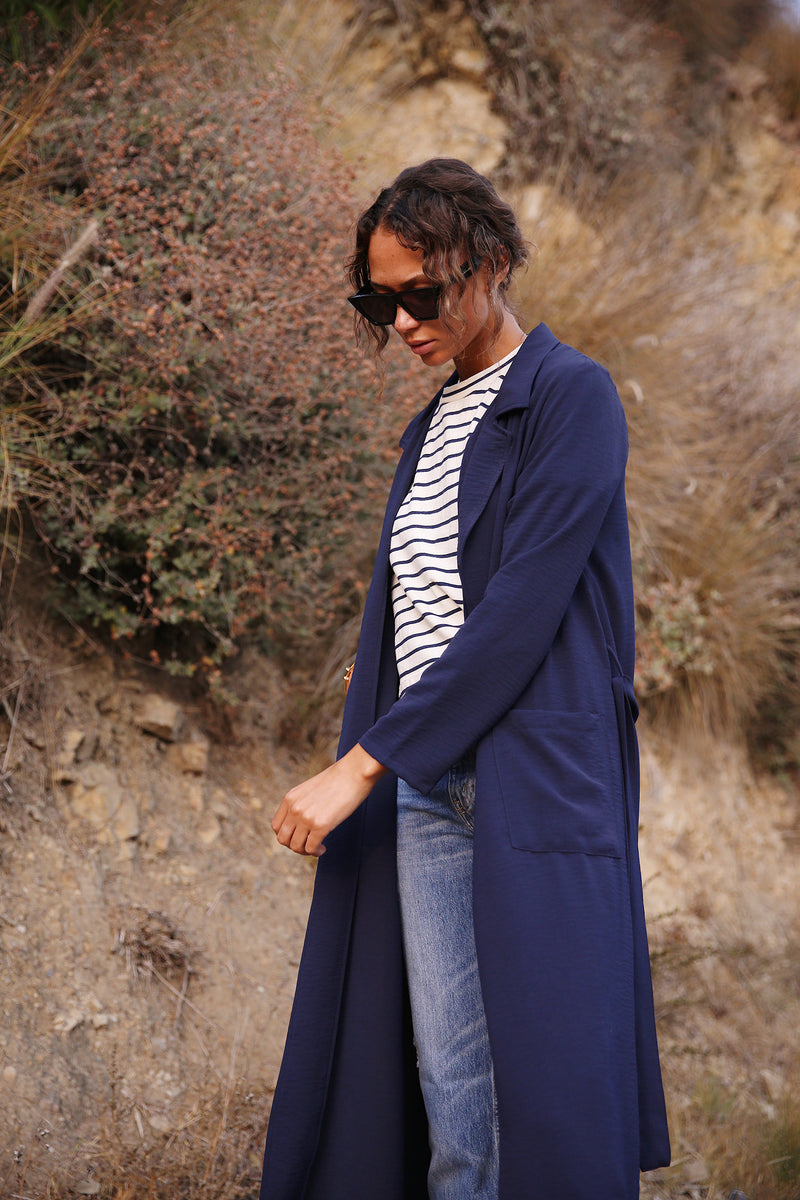 Model wearing the lady & the sailor Belted Coat in Navy Air Flow.