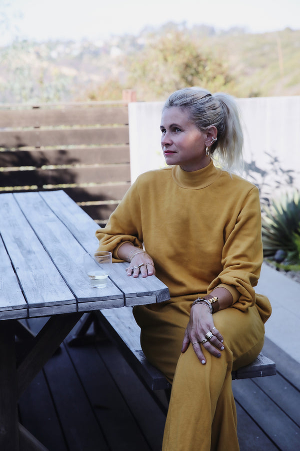 Model wearing the lady & the sailor Balloon Sleeve Mockneck in Golden Hour Fleece.