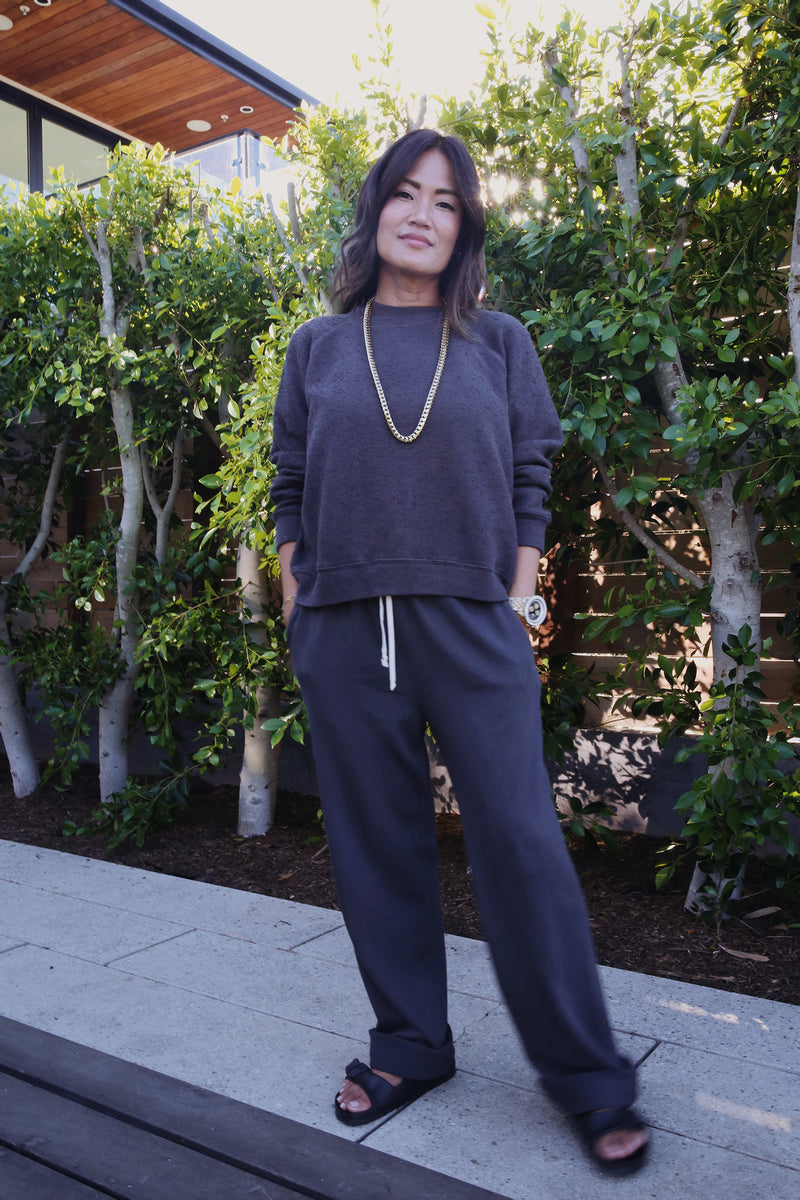 Model wearing the lady & the sailor the Heather Pant in Slate Organic Cotton.