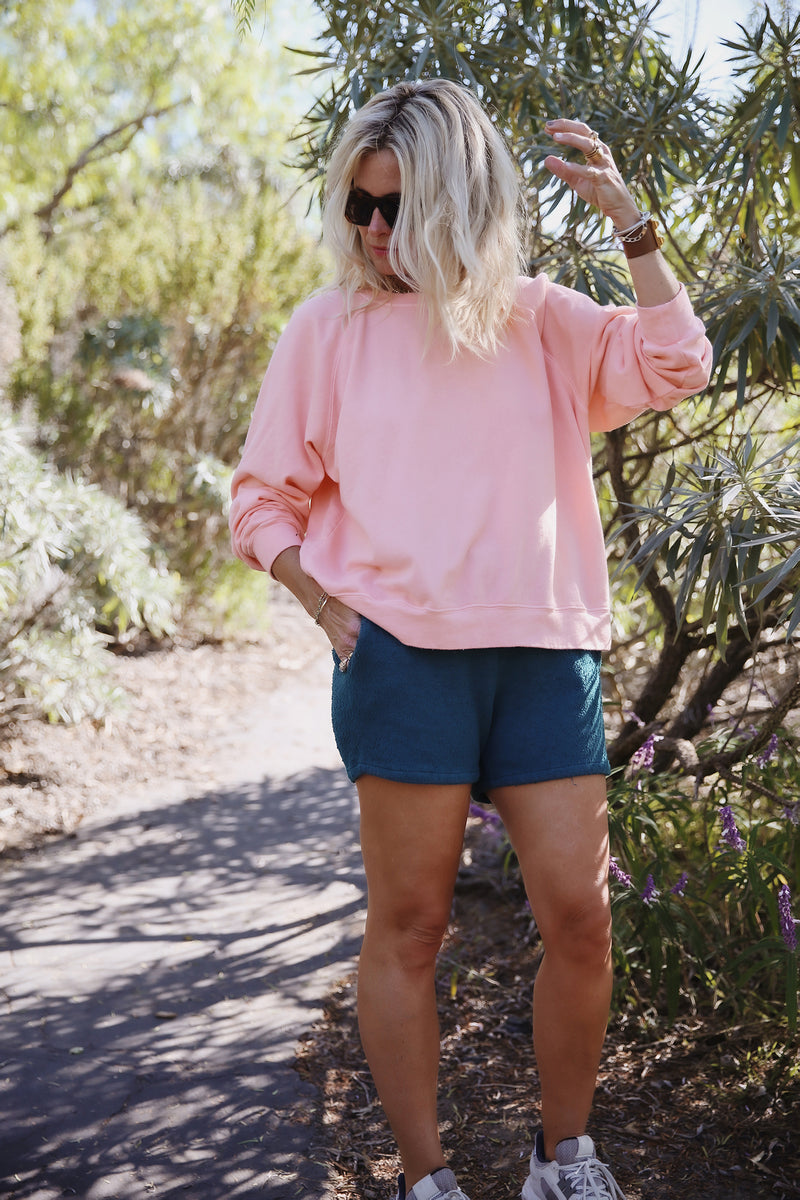 Model wearing the lady & the sailor Brentwood Sweatshirt in Sunset Pink Organic Cotton.