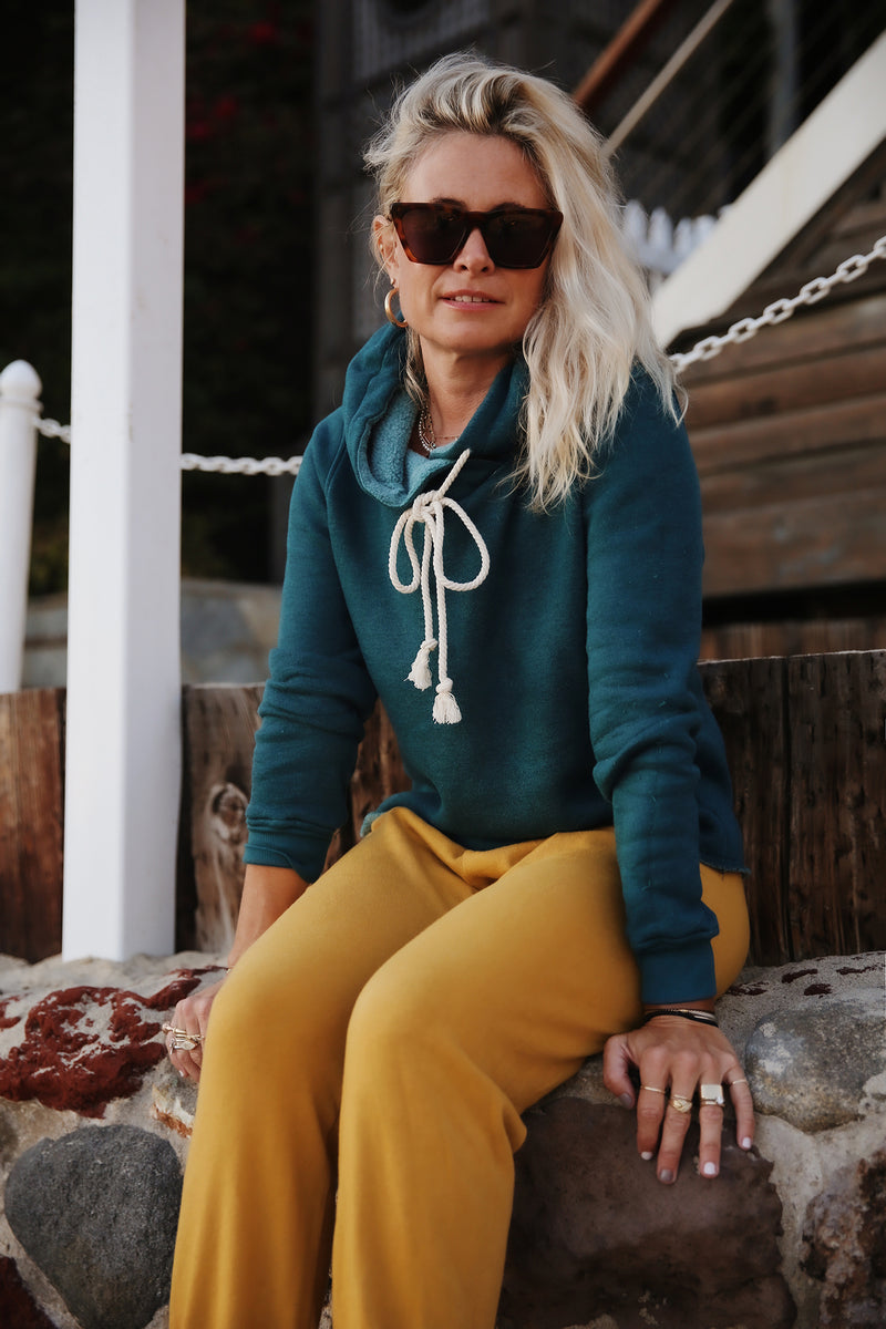 Model wearing the lady & the sailor Vintage Sweatpant in Golden Hour Organic Cotton.