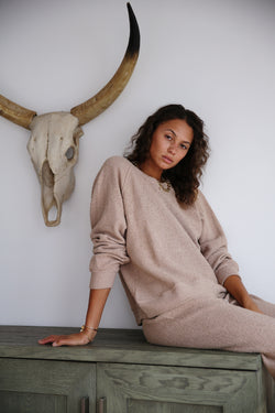Model wearing the lady & the sailor Brentwood Sweatshirt in Sand Boucle.