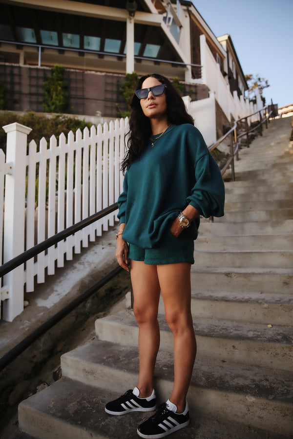 Model wearing the lady & the sailor Weekend Short in Emerald Bay Green Boucle.