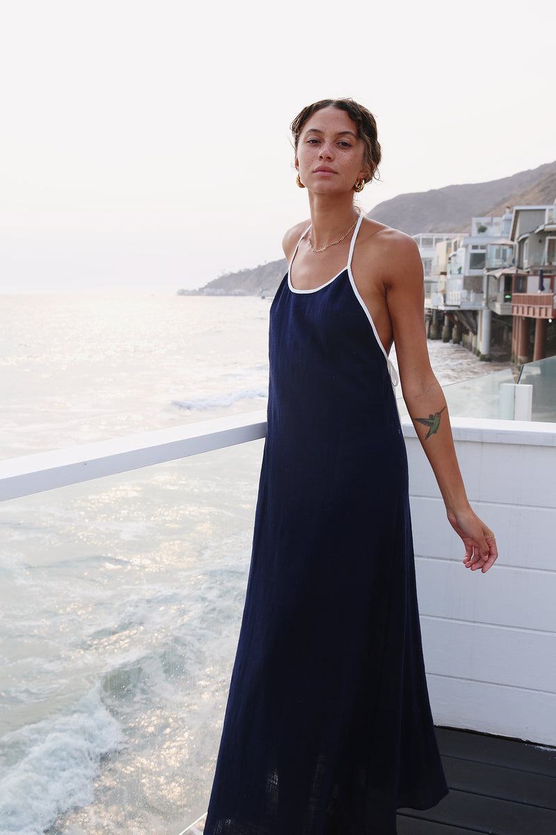 Model wearing the lady & the sailor Mila Dress in Navy with White Trim.
