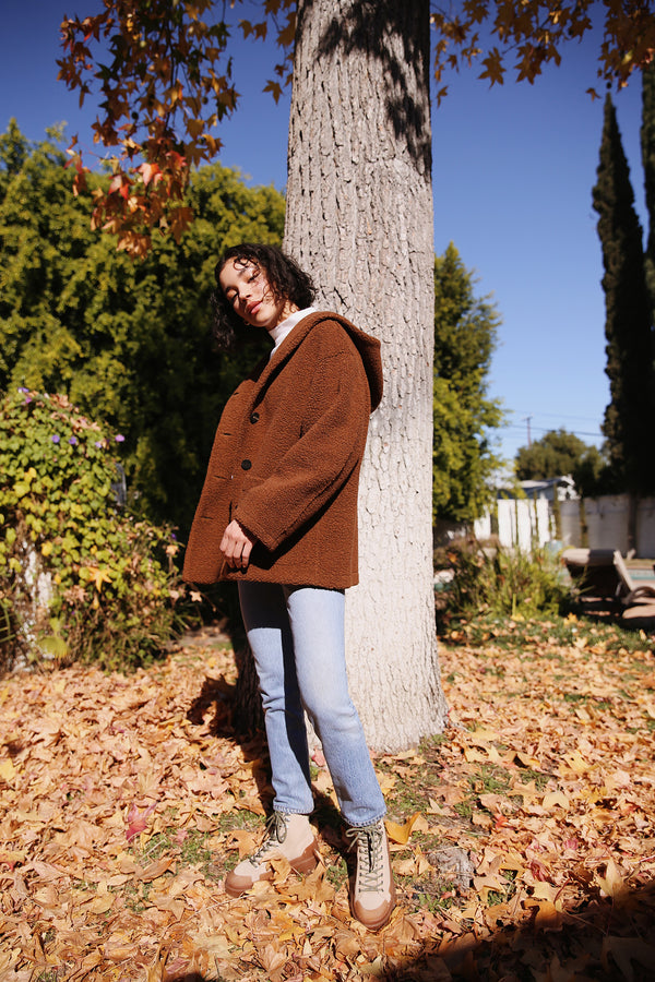 Model wearing the Harris Wharf Oversized Hooded Jacket in Caramel.