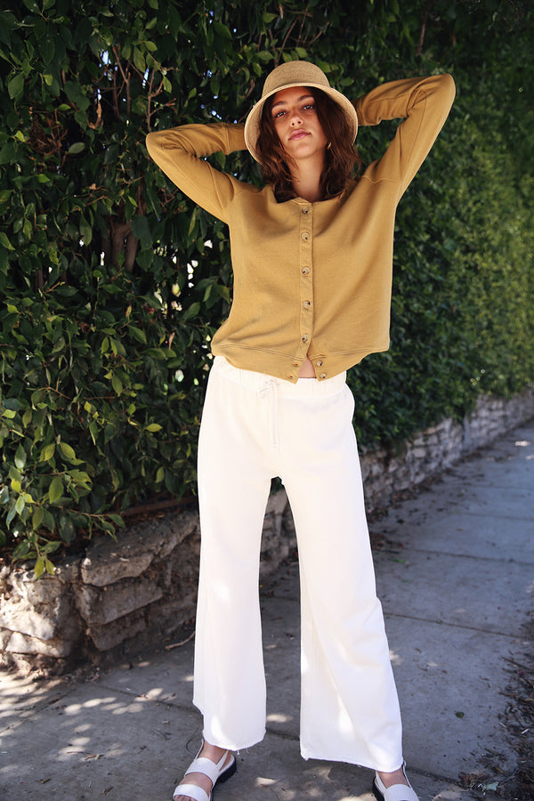 Model wearing the lady and the sailor French Flare Pant in Vanilla Organic Cotton.
