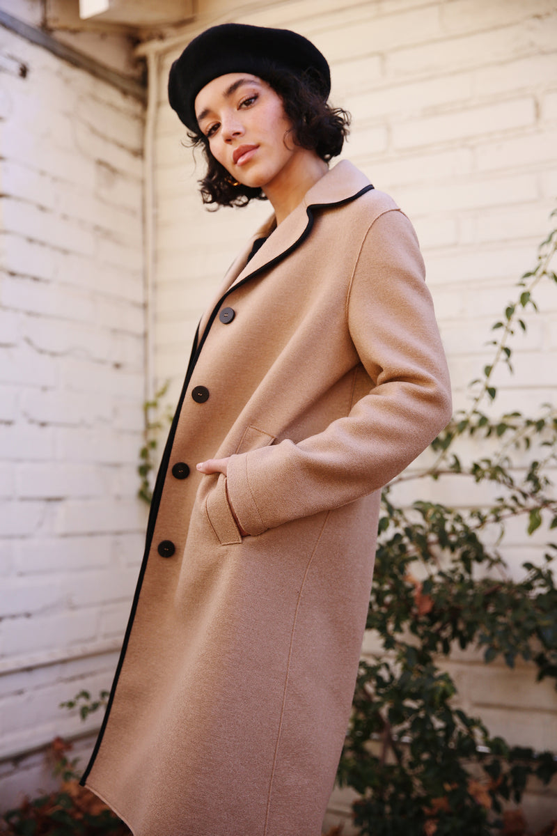 Model wearing Harris Wharf Contrast Piped Coat in Tan Pressed Wool.