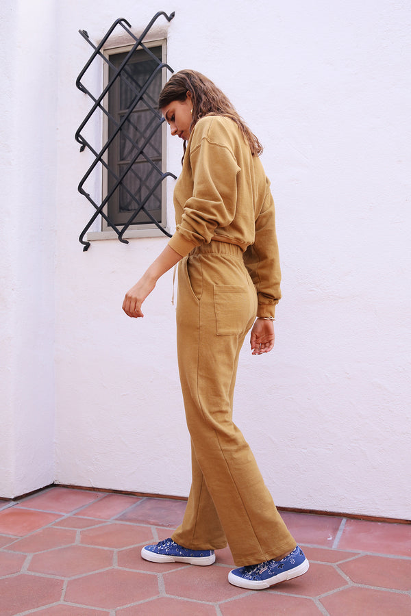 Model wearing the lady & the sailor Straight Leg Pocket Sweatpant in Marigold Organic Cotton.