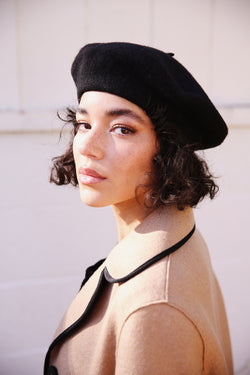 Model wearing Hatattack Wool Beret in Black.