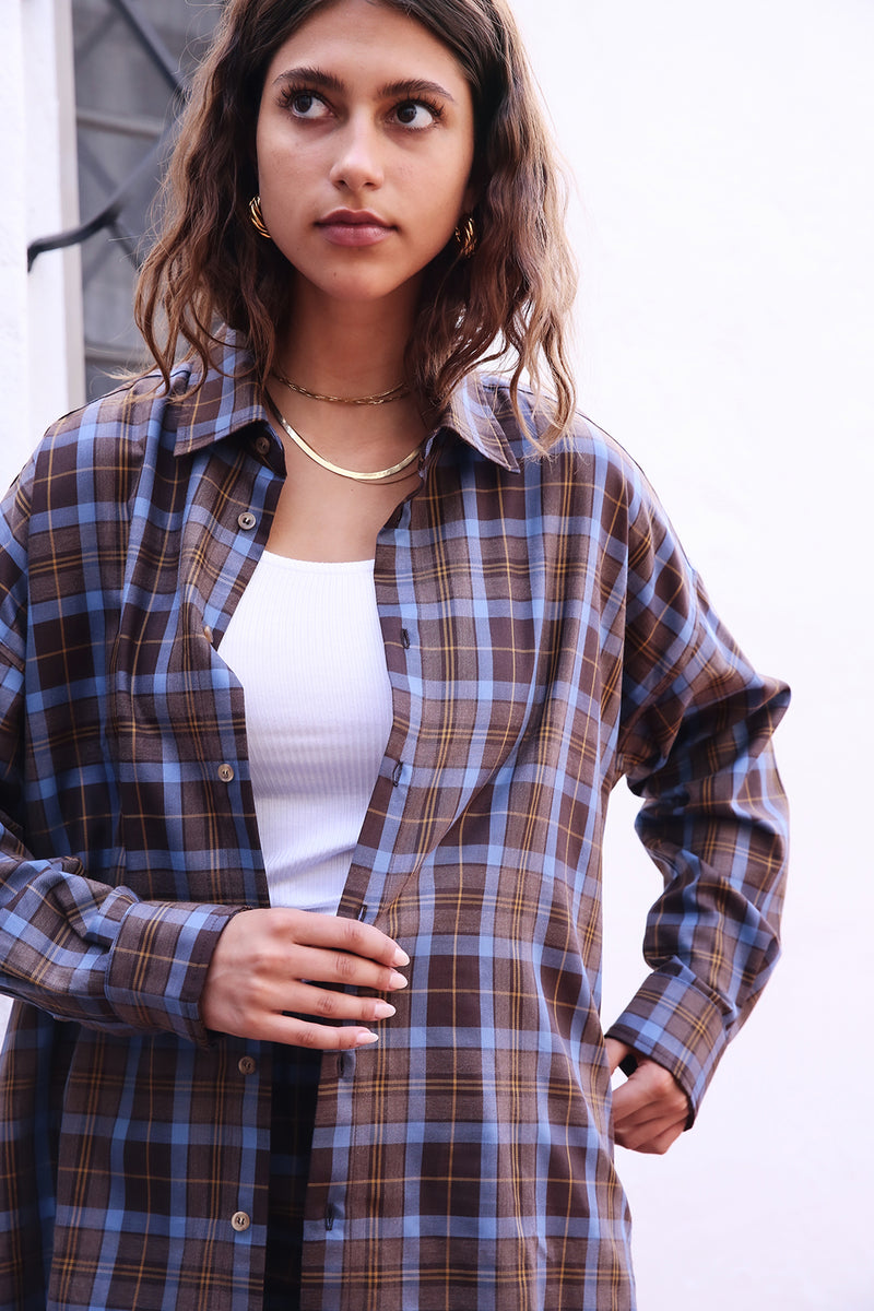 Model wearing the lady & the sailor the Sunday Shirt in Mocha Plaid.