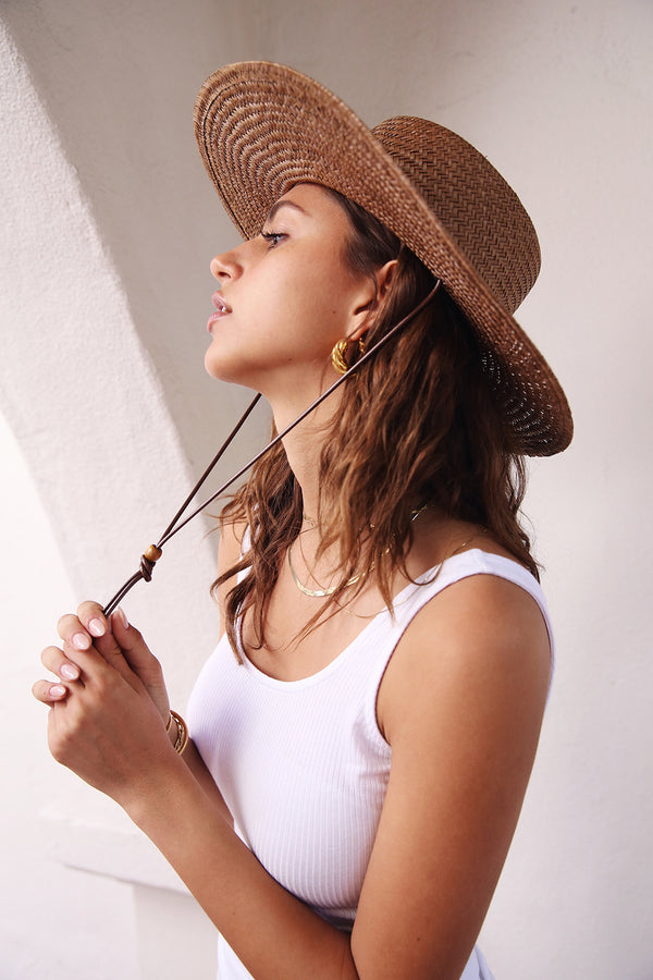 Model is wearing Lack of Color Vienna Hat in Brown.