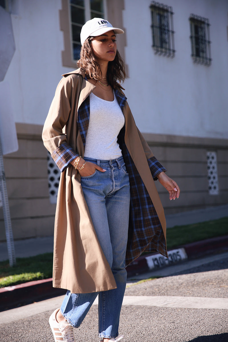 Model wearing the lady & the sailor Double Breasted Raglan Trench in Camel/Mocha Plaid.