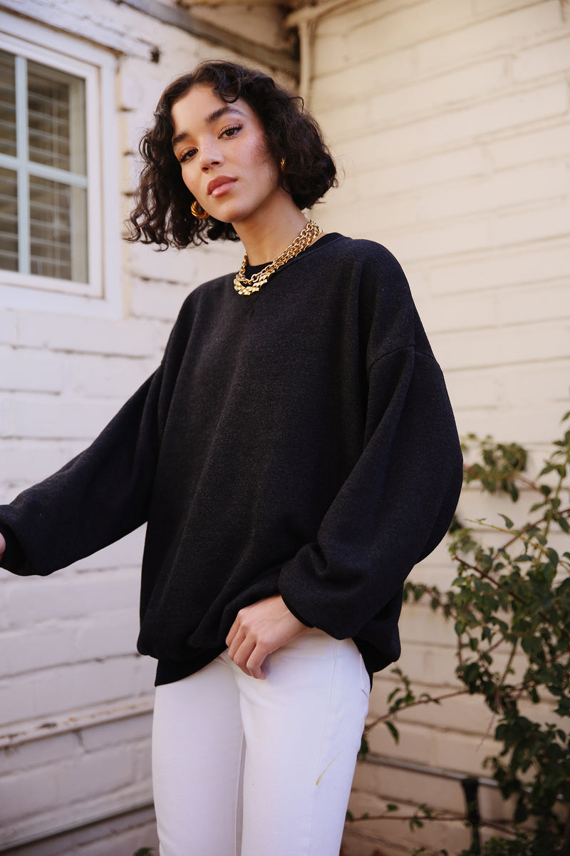 Model wearing the lady & the sailor The Sandi Sweatshirt in Heathered Black Fleece.