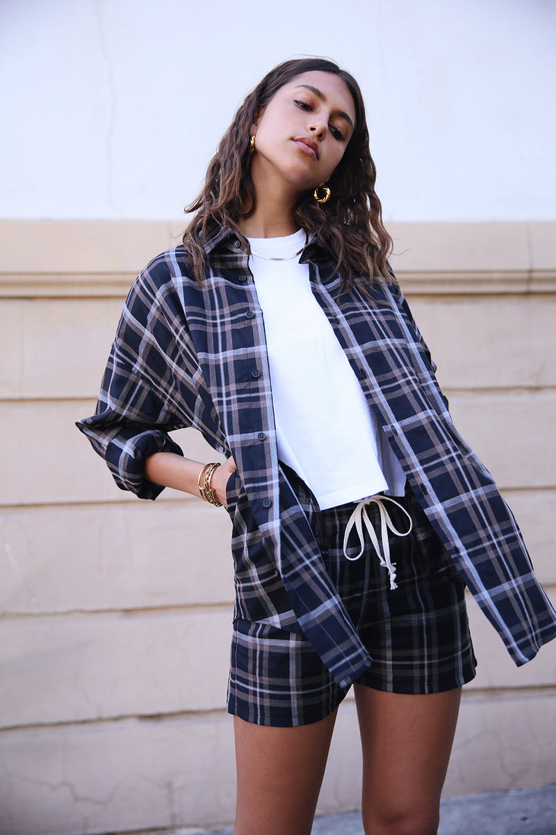 Model wearing the lady & the sailor the Sunday Shirt in Black Plaid.