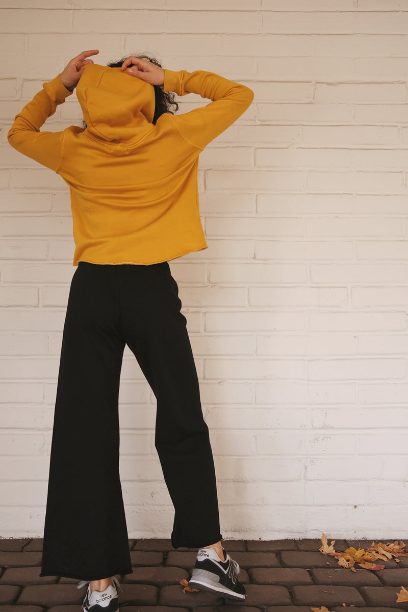 Model wearing the lady & the sailor French Flare Pant in Black Organic Cotton.