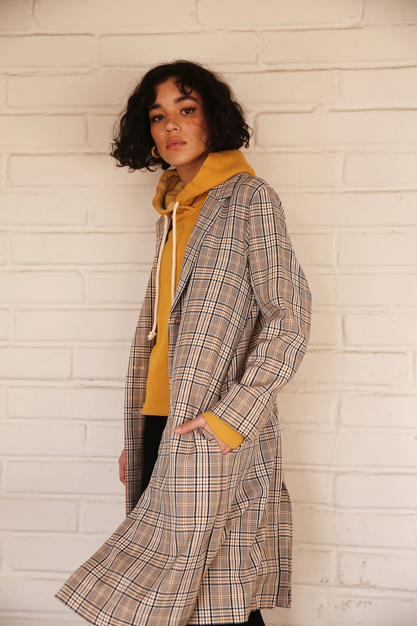 Model wearing the lady & the sailor Midi Blazer in Mustard Plaid.