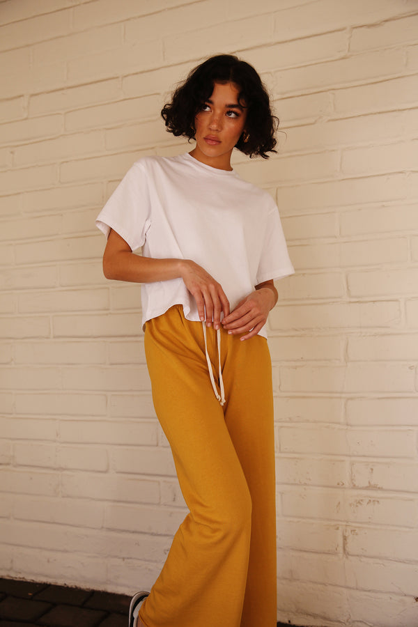 Model wearing the lady & the sailor French Flare Pant in Golden Hour Organic Cotton.