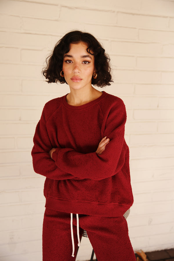 Model wearing the lady & the sailor Brentwood Sweatshirt in Bordeaux Boucle.