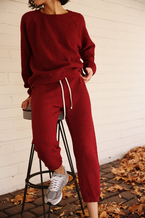 Model wearing the lady & the sailor Vintage Sweatpant in Bordeaux Boucle.