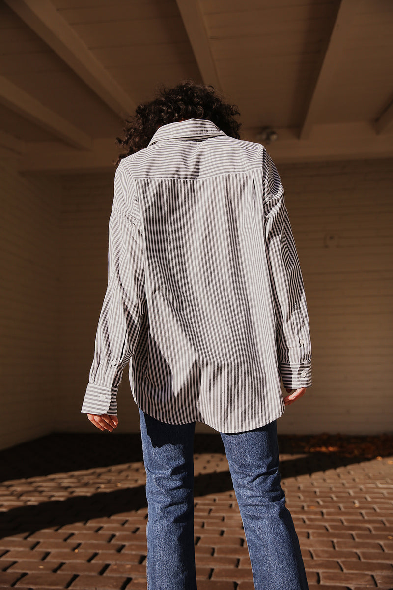 Model wearing the lady & the sailor Sunday Shirt in Graphite Stripe.