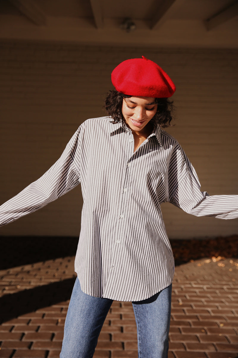 Model wearing Hatattack Wool Beret in Red.