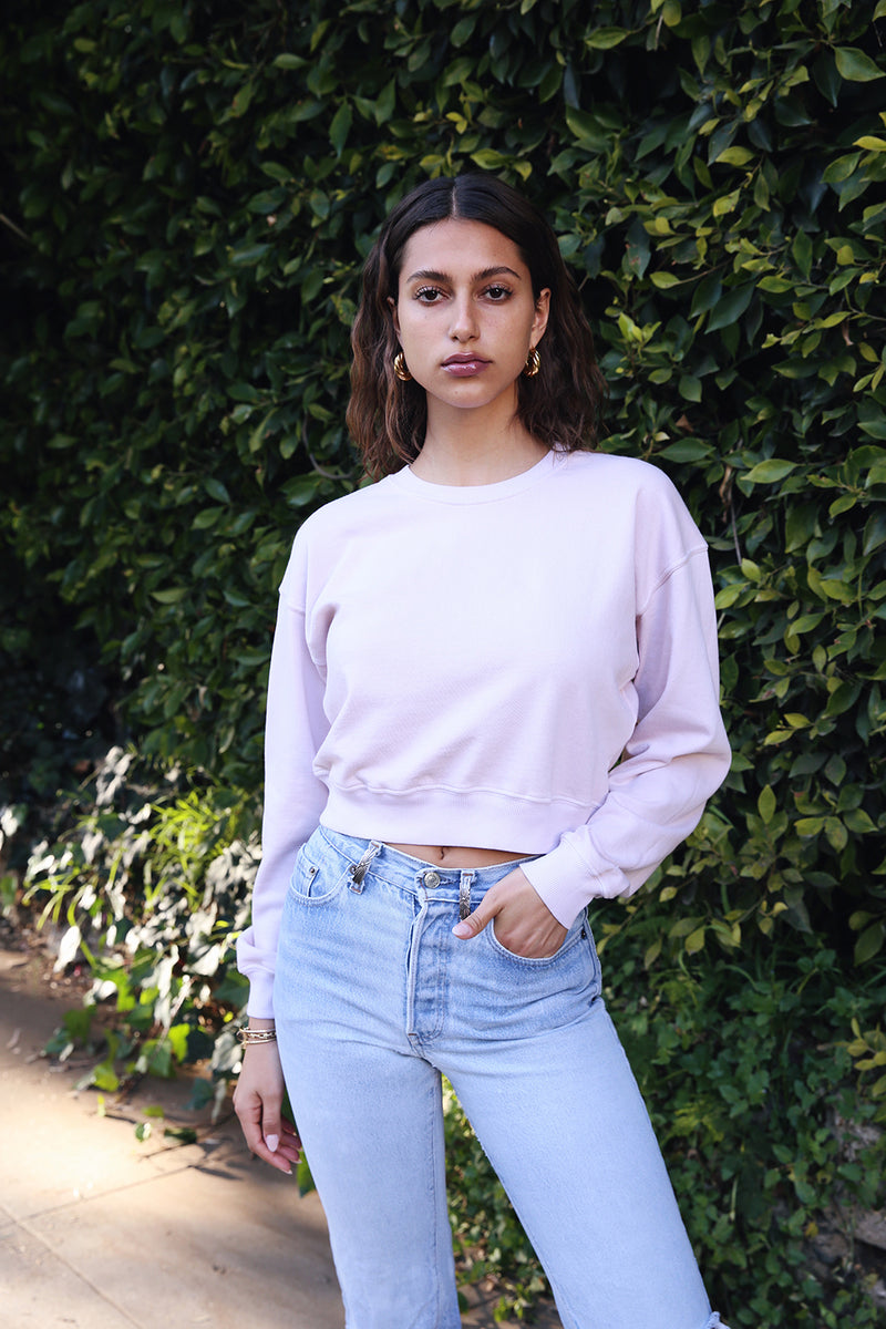 Model wearing the lady and the sailor Cropped Sweatshirt in Rose Organic Cotton.