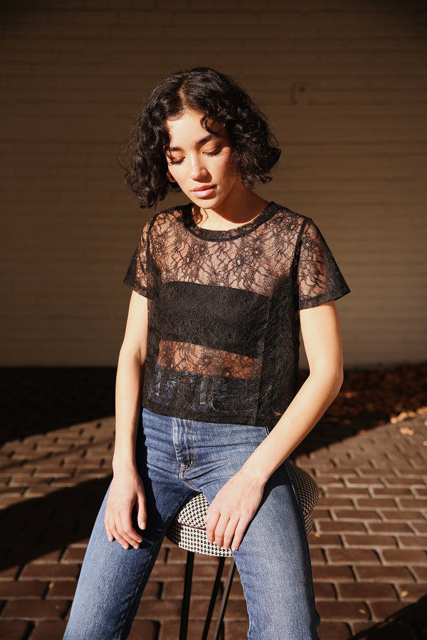 Model wearing the lady & the sailor Cropped Lace Tee in Black Eyelash.