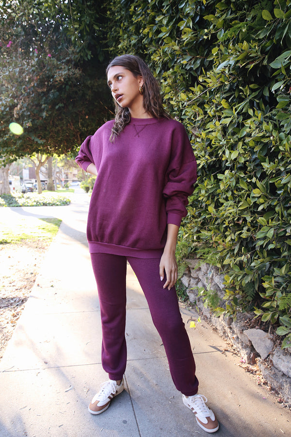 Model wearing the lady & the sailor Full Length Vintage Sweatpant in Berry Fleece.